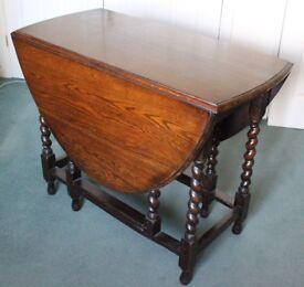 Dining table oval gate leg drop-leaf dark wood barley twist legs