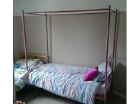 Pink, four post, single bed frame