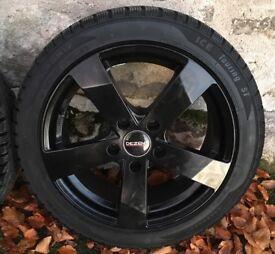 Winter tyres 225/45/17 on black rims vgc