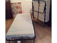 2 single folding beds & mattresses, will sell separately.