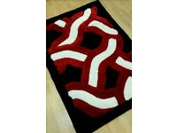 Brand new red black and white rug