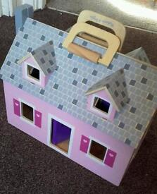 Little wooden dolls house to carry
