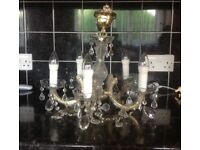 Beautiful Glass Chandelier , comes with 5 dimmable LED energy saving candle style bulbs.