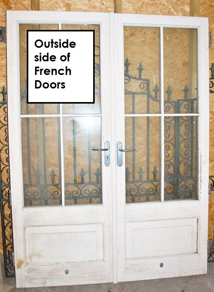 White Wooden French Doors With Double Glazed Windows In