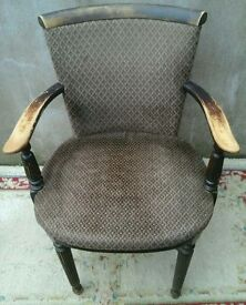 Vintage upholstered wooden chair with arms