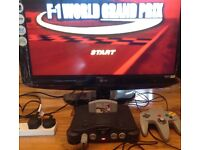 Nintendo N64 Console 2 Games F1 World Grand Prix and WWF War Zone Nintendo 64