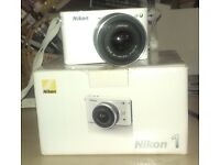 Excellent Condition White Nikon1 J2. My camera wants more attention than I give it :)