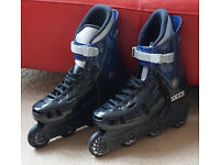 Adult in line roller blades, nearly new, size 9. Including knee, elbow & wrist pads, also adult.