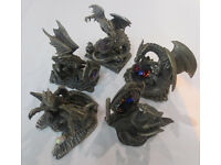 5 pewter ornaments of dragons with crystals