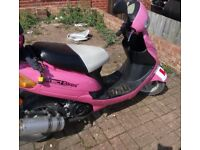 Pink 49cc moped by direct bikes. Ready to drive away today includes a full face road legal helmet!!!