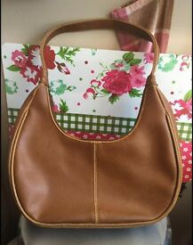 Brown handbag has some sight defects see pics can post)