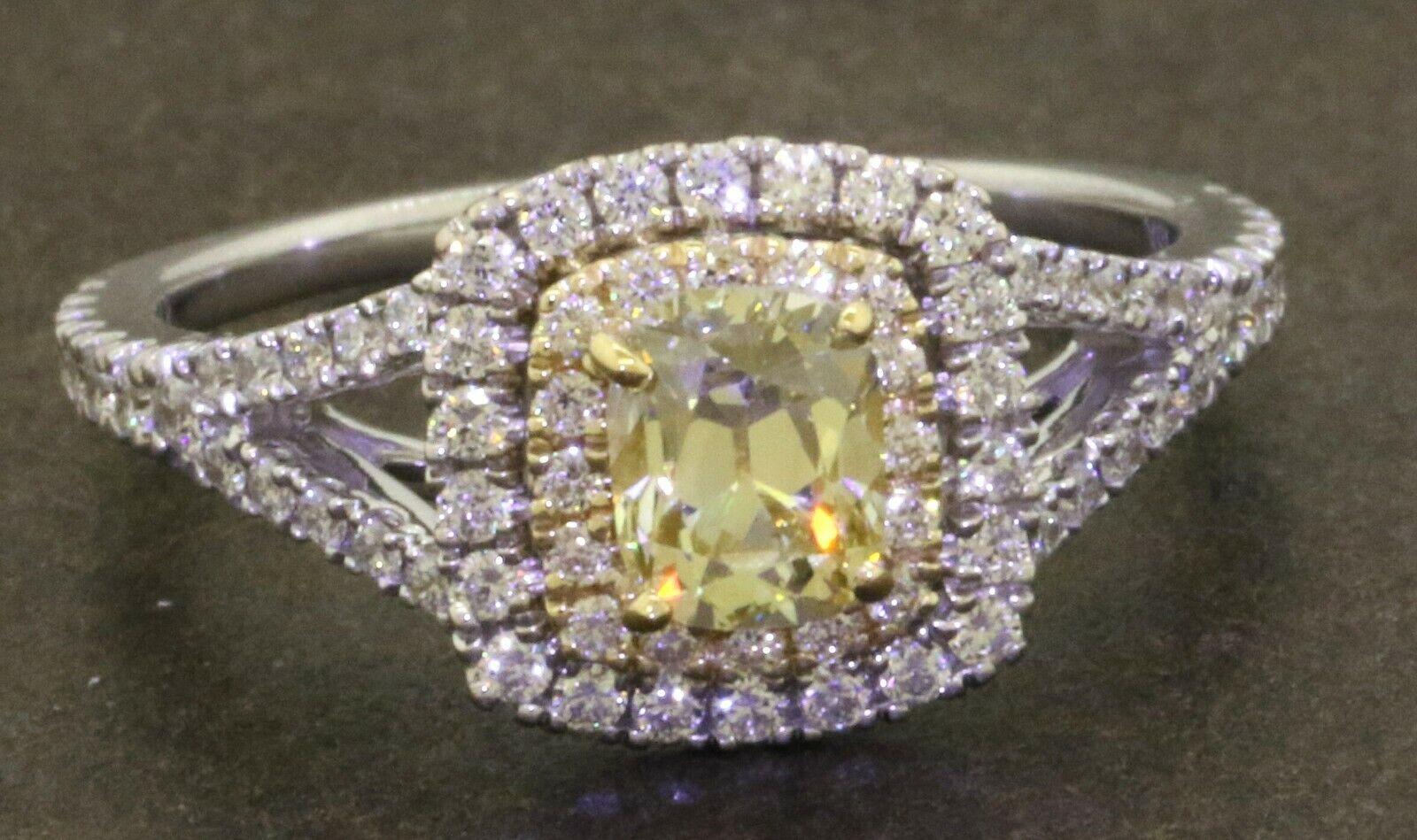18K WG 1.12CTW VS Natural Fancy Light Yellow diamond wedding ring w/ .59CT ctr.
