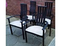 4 wooden dining chairs. cushion padded seats. In used condition, need a good cleaning.