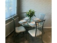 Glass dining table and 4x chairs