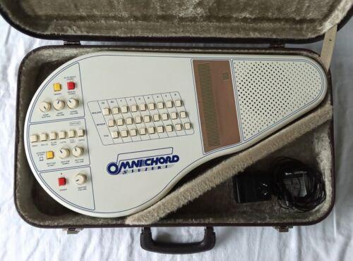Suzuki Omnichord OM-27 autoharp with hard case, power supply, songbook 1980s