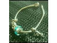 Genuine Pandora Bracelet with 5 genuine charms