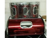 Brand new red metal bread bin and canister set