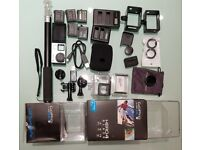 GoPro Hero4 Black Edition Bundle (with extra batteries, LCD screen, cages, waterproof case etc.)