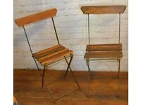 Pair of French bistro metal folding chairs vintage garden industrial seating restaurant cafe