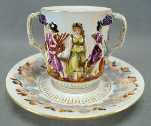 19th Century Capodimonte Style Figural Double Handled Chocolate Cup & Saucer