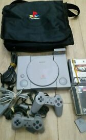 PlayStation 1 complete console with games memory card on carry