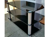 black glass Tv media table. 80cm wide x 45cm depth. In very good condition.