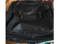 Retro dark brown leather style suit carrier