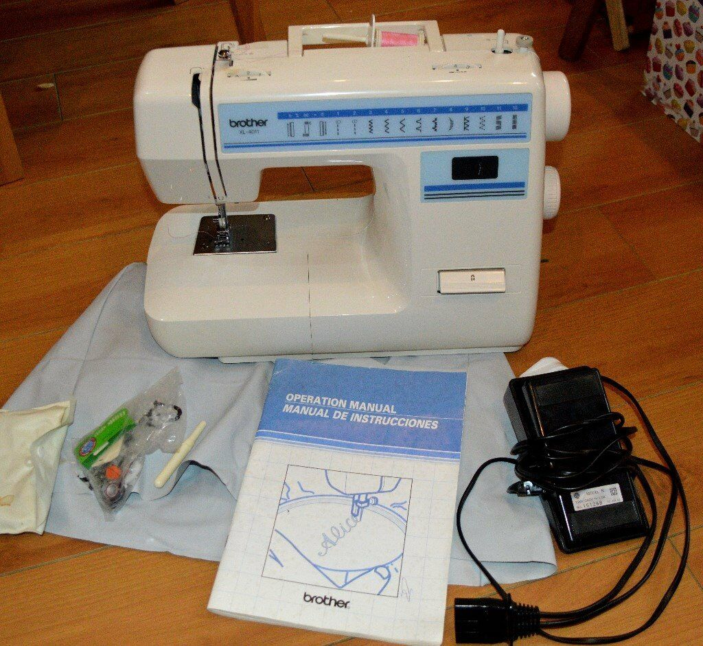 Brother sewing machine with sewing accessories and instruction booklet