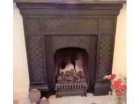 Beautiful old cast iron fireplace complete