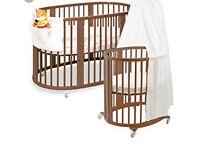 Stokke sleepi mini crib and cot.