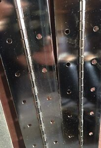 Three long stainless steel piano hinges