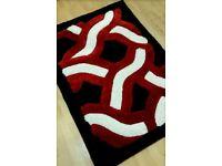 Brand new sealed black / red / white rug