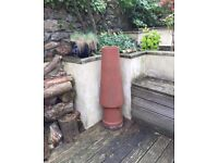 Terracotta chimney pot just over 1m tall