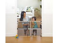 Munchkin extendable pet barrier pressure mounted .