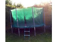 12' Trampoline with net and cover.