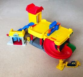 Fisher-Price garage for 'Dinky' sized toy cars and trucks.
