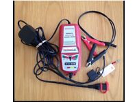 Red Optimate 3,Charger. New.shape.with Croc clips and Permanent bike fitting..