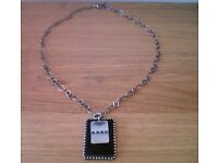 JAMIE COWHIDE AND STEEL NECKLACE