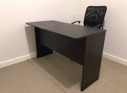 Dark brown desk with drawers & black chair in very excellent cond