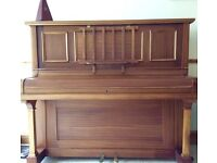 Upright piano, regularly played but now requires retuning.