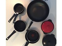 9 barely used Tefal pans, new wok and griddle pan and 2x casserole dishes