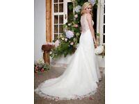 Beautiful designer unworn wedding dress