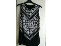 Ladies , new look black sleeveless T-shirt with print , size 8