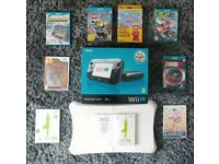 Nintendo Wii U (used but boxed) + 8 games and balance board