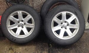 Two Chrysler 300 P215/65/R17. Tires and rims.