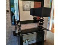 Gorgeous black glass consol table, large mirror and large lamp set.