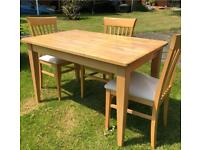 Table and 3 chairs - solid and sturdy, good condition