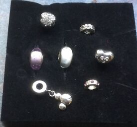 Silver Pandora style charms some Disney themed