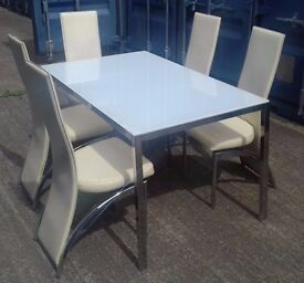 White glass dining table with 5 faux-leather dining chairs