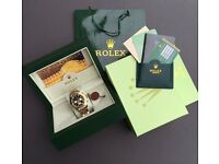 Gold & Silver Daytona Rolex with black face. Box, bag & paperwork included